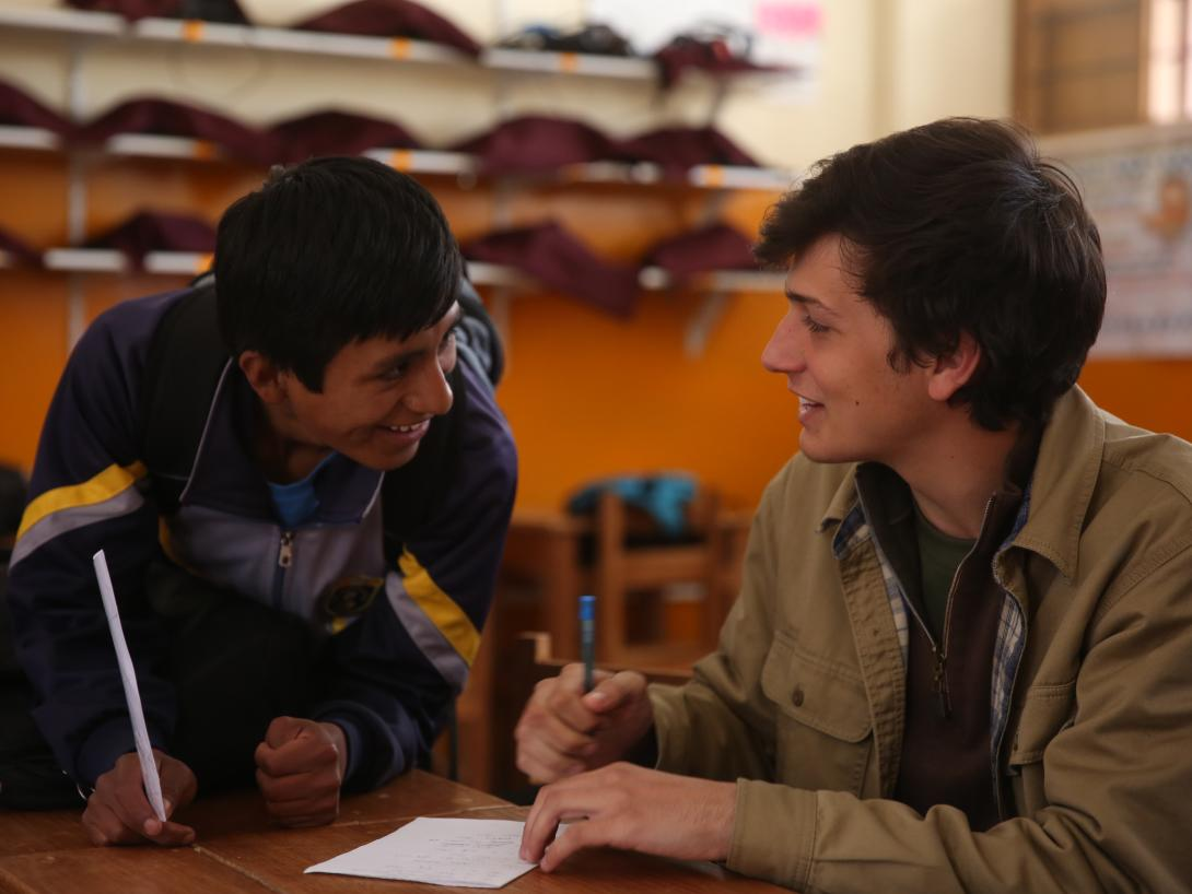 A student in Peru on a Service Learning Program for college students works in a high school.